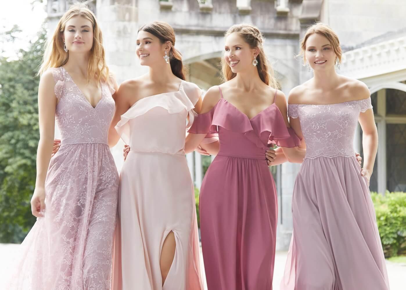 Photo of bridesmaids wearing pink and purple dresses