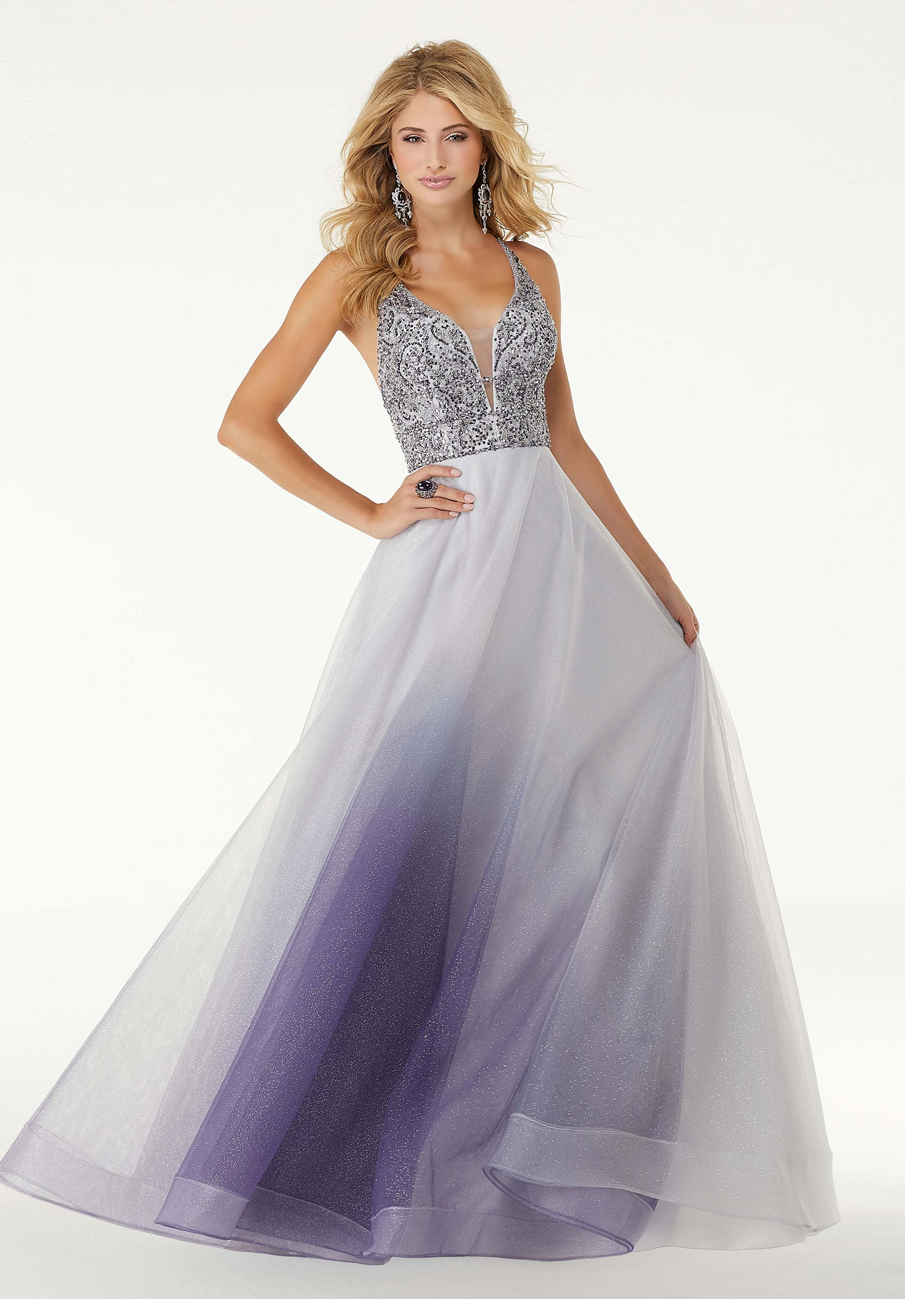 Photo of prom girl wearing a blue sparkling evening dress